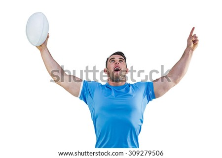 Rugby player cheering and pointing on white background