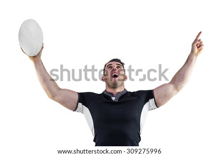 Rugby player cheering with the ball on white background