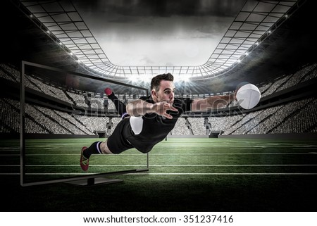 Rugby player scoring a try against rugby arena - stock photo