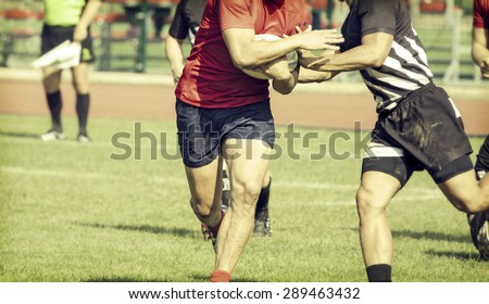 Rugby players fighting for ball - sports concept, retro style photo - stock photo