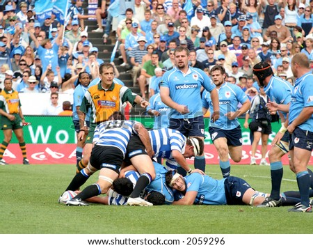 Rugby players in a loose scrum - stock photo