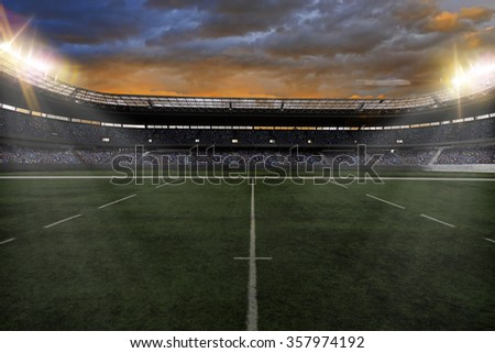 Rugby Stadium with fans wearing blue uniforms - stock photo