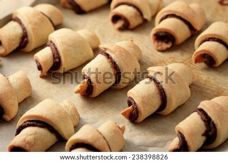 Rugelach with chocolate filling. Traditional Jewish holiday cookie  - stock photo