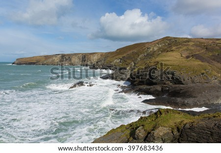 Rugged Cornwall coast with waves at Trebarwith Strand Cornwall England UK coastal village between Tintagel and Port Isaac