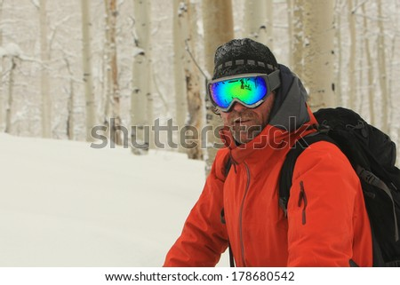Rugged male skier with aspen trees in the background, Utah, USA. - stock photo