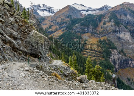 Rugged Mountain Road - A cloudy autumn day on rugged four-wheel drive Black Bear Pass trail, above Bridal Veil Falls and its historic hydroelectric power plant. - stock photo