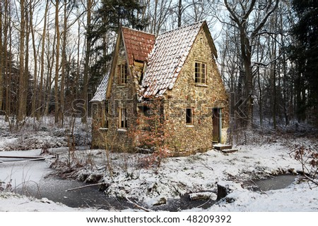 ruin in forest. lodge or small house abandoned and falling down. architecture built in flint and stone with water around or in lake in winter - stock photo