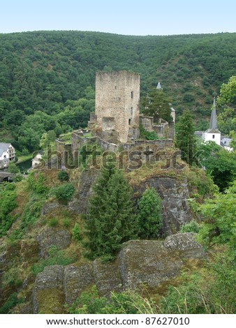 "ruin in front of a city named ""Esch-sur-Su00fbre in Luxembourg at summer time - stock photo"