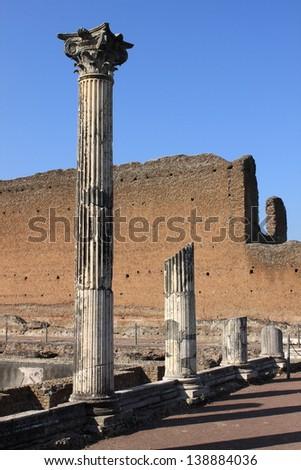 Ruin of ancient corinthian columns in Villa Adriana near Rome, Italy - stock photo