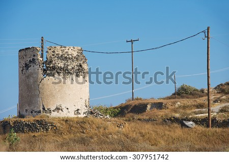 Ruin of ancient windmill at Santorini island, Greece. - stock photo