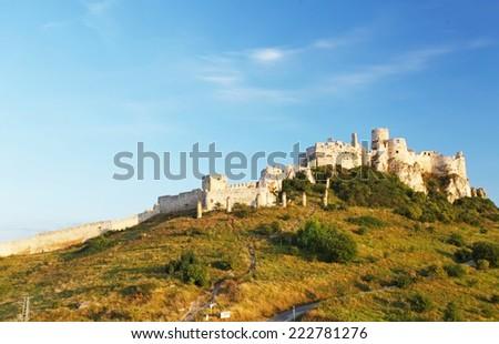 Ruin of Spissky Castle in Slovakia at sunrise - stock photo