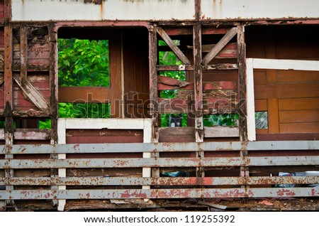 Ruin wooden building in the middle of urban slum in frame shape - stock photo