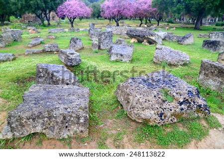 Ruined blocks of stone in ancient sanctuary of Zeus, Olympia, Greece - stock photo