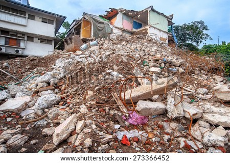 Ruined Building - Pieces of Metal and Stone are Crumbling from Demolished Building Floors - stock photo
