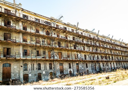 Ruined buildins in the old port of Trieste - stock photo