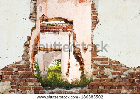 Ruined house walls with blue sky  - stock photo