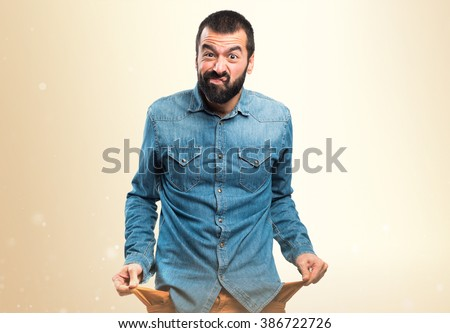 Ruined man looking money in their pockets - stock photo