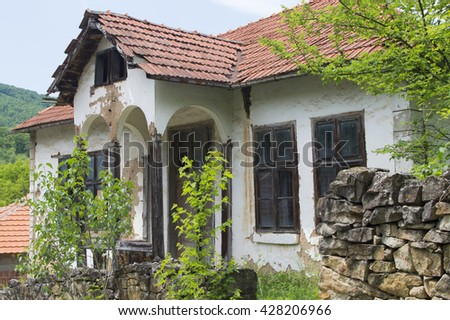 Ruined old rural cottage, deserted village in a poor border area of Serbia - stock photo