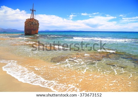 Ruined shipwreck resting on golden sands of Selinitsa beach, Gythio, Greece - stock photo
