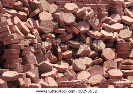 Ruined stack of road slabs - stock photo