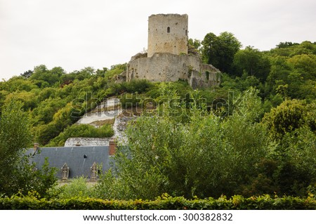 """Ruines of medieval castle over La Roche-Guyon village (Ile-de-France, France). La Roche-Guyon is included in the list of """"The most beautiful villages of France"""".  - stock photo"""