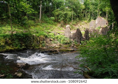 Ruins By River - stock photo