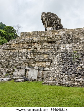 Ruins of a building with huge plates in its base in the ancient city of Palenque - Mexico, Lstin America - stock photo