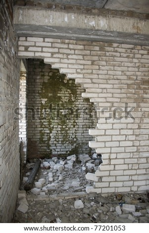 Ruins of a destroyed house. Abandoned building. War time - stock photo