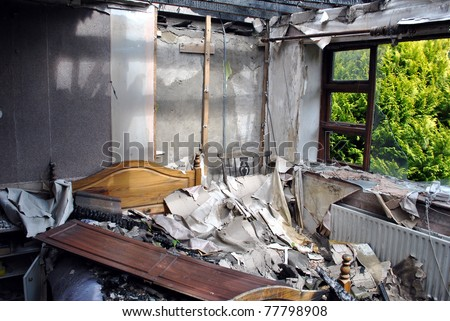 ruins of a destroyed residence after a house fire - stock photo