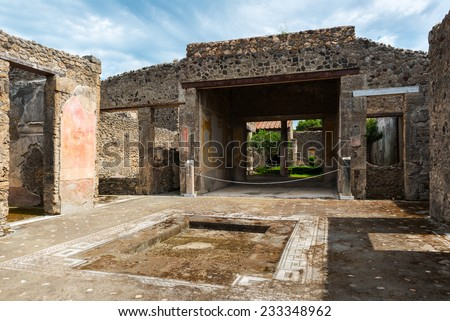 Ruins of a house in Pompeii, Italy. Pompeii is an ancient Roman city that died after the eruption of Mount Vesuvius in 79 AD. - stock photo