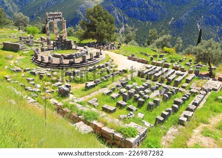Ruins of a large temple dedicated to Athena the Greek goddess, at Delphi, Greece - stock photo