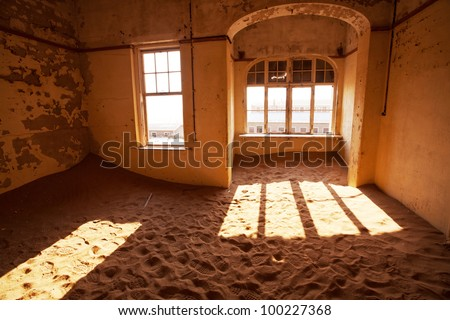 Ruins of abandoned houses in the ghost diamond town Kolmanskop, Namibia, Africa in storm