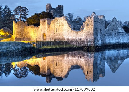 Ruins of Adare castle at the river in Ireland - stock photo