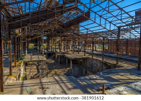 Ruins of an abandoned old factory. The remains of the steel structure.