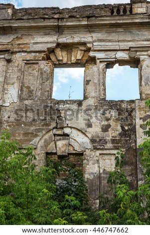 Ruins of an ancient house in Odessa, Ukraine. Historic building destroyed by vandals of proletariat during revolution in Russia in 20th century. Ruins of a large beautiful villa