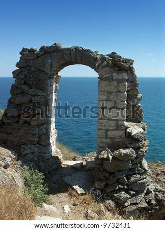 Ruins of an ancient stone arch (Kaliakra - Bulgaria) - stock photo