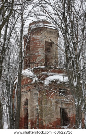 Ruins of ancient cathedral in winter - stock photo