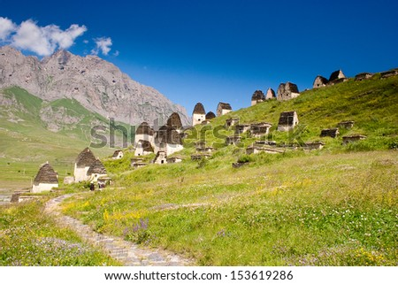Ruins of ancient settlement in the Caucasus mountains (tombs and sarcophagus