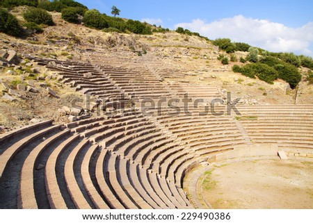 Ruins of ancient theater in Assos in Turkey. - stock photo