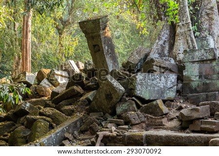 Ruins of Angkor Wat, part of Khmer temple complex, Asia. Siem Reap, Cambodia. Ancient Khmer architecture in jungle. - stock photo