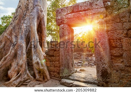Ruins of Cambodian temple at sunset - stock photo