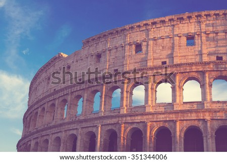 ruins of Colosseum at sunset in Rome, Italy, retro toned - stock photo