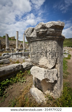 Ruins of Column with Greek Text at Perga in Turkey - stock photo