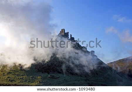 Ruins of Corfe Castle, in Swanage, Dorset, Southern England as seen from the steam train running alongside.