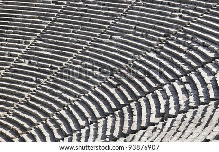 Ruins of Epidaurus amphitheater, Greece - archaeology background - stock photo