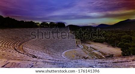 Ruins of Epidaurus amphitheater, Greece - archaeology background.Sunset. - stock photo