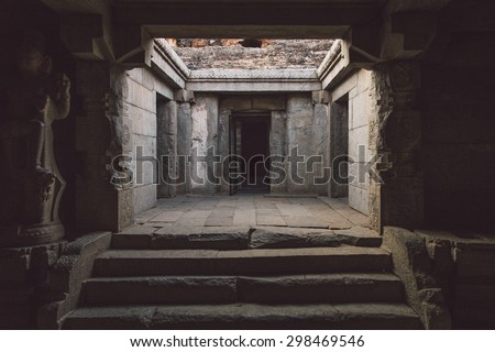 Ruins of Hampi are a UNESCO World Heritage Site. Achyutaraya Temple. Post-processed with grain, texture and colour effect. - stock photo