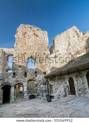 Ruins of medieval castle Ogrodzieniec, located on the Trail of the Eagles' Nest within the Krakow-Czestochowa Upland, Poland - stock photo