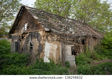 ruins of old abandoned house - stock photo