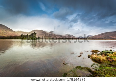 Ruins of old castle in Scotland over the lake